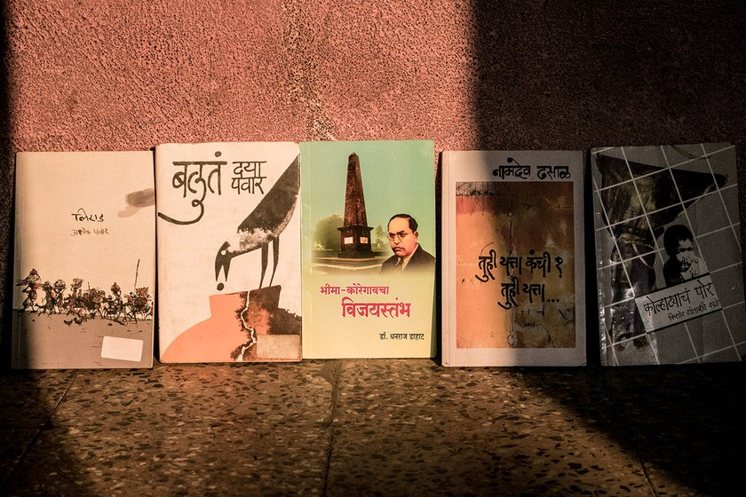 Books on Dalit literature lined up against a wall