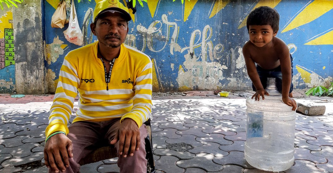 Siddharth – here, with his son Akshay – used to work at construction sites. 'That stopped when the lockdown began', he says