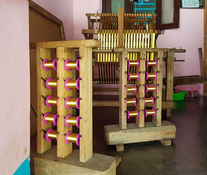 The charkha in Mani's house used to spin the kasavu into smaller rolls