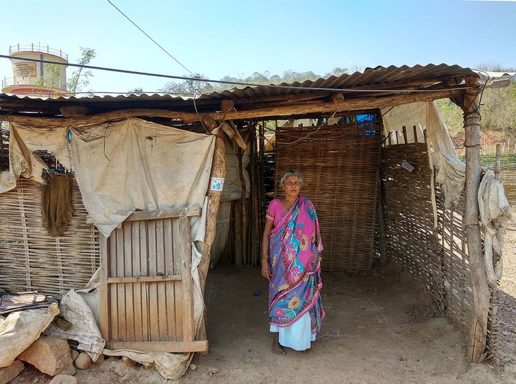 Rapaka Devaschamma, mother of Rapaka Venkatesh, in front of the house she constructed with bamboo in the Resettlement Colony of Pydipaka. The government is supposed to give her a concrete house but hasn't given one till date.