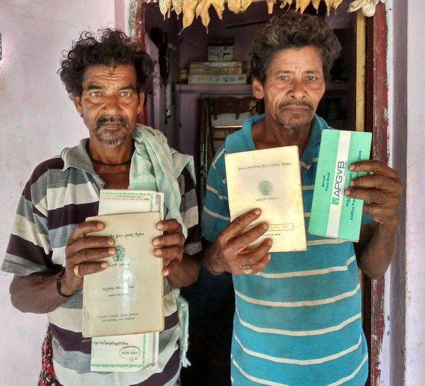Bantu Durga Rao and Yagati Asrayya with their passbooks in front of Durga Rao's house in Kotapalem