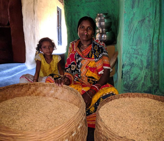 Rukmani Khillo set to pack and store Machhakanta and Muktabali rice varieties for the next sowing season