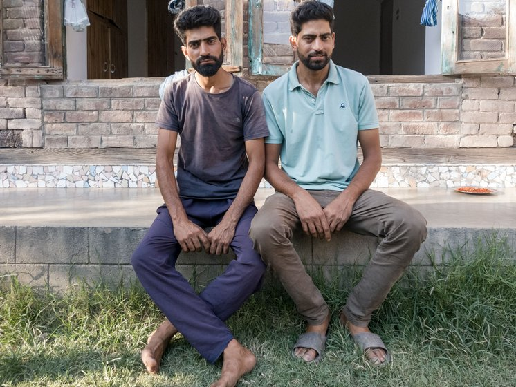 'In Dal, except tourism, we can't do much,' says Shabbir Ahmad (sitting on the right), now working on the lake's de-weeding project with his brother Showkat Ahmad