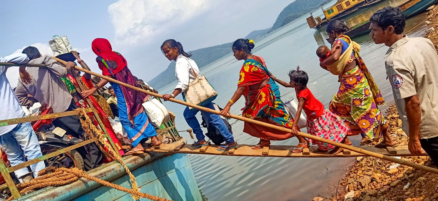Kusama Naria (left), nearly nine months pregnant, walks the plank to the boat (right, in red saree) for Chitrakonda to get corrections made in her Aadhaar card