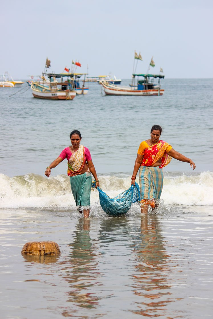 Left: 'We need to do something to fill our stomachs', says an elderly fisherwoman, as she walks a kilometre across Dandi beach in Malwan to the auction site to sell her family's catch of tarli (sardine). Right: Women wash the fish to be to be salted and sun-dried
