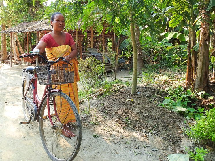 Sama heads to the market on her bicycle