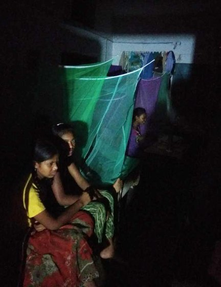 Girls in a residential hostel in Farsegarh singing softly with the lights switched off, after school hours