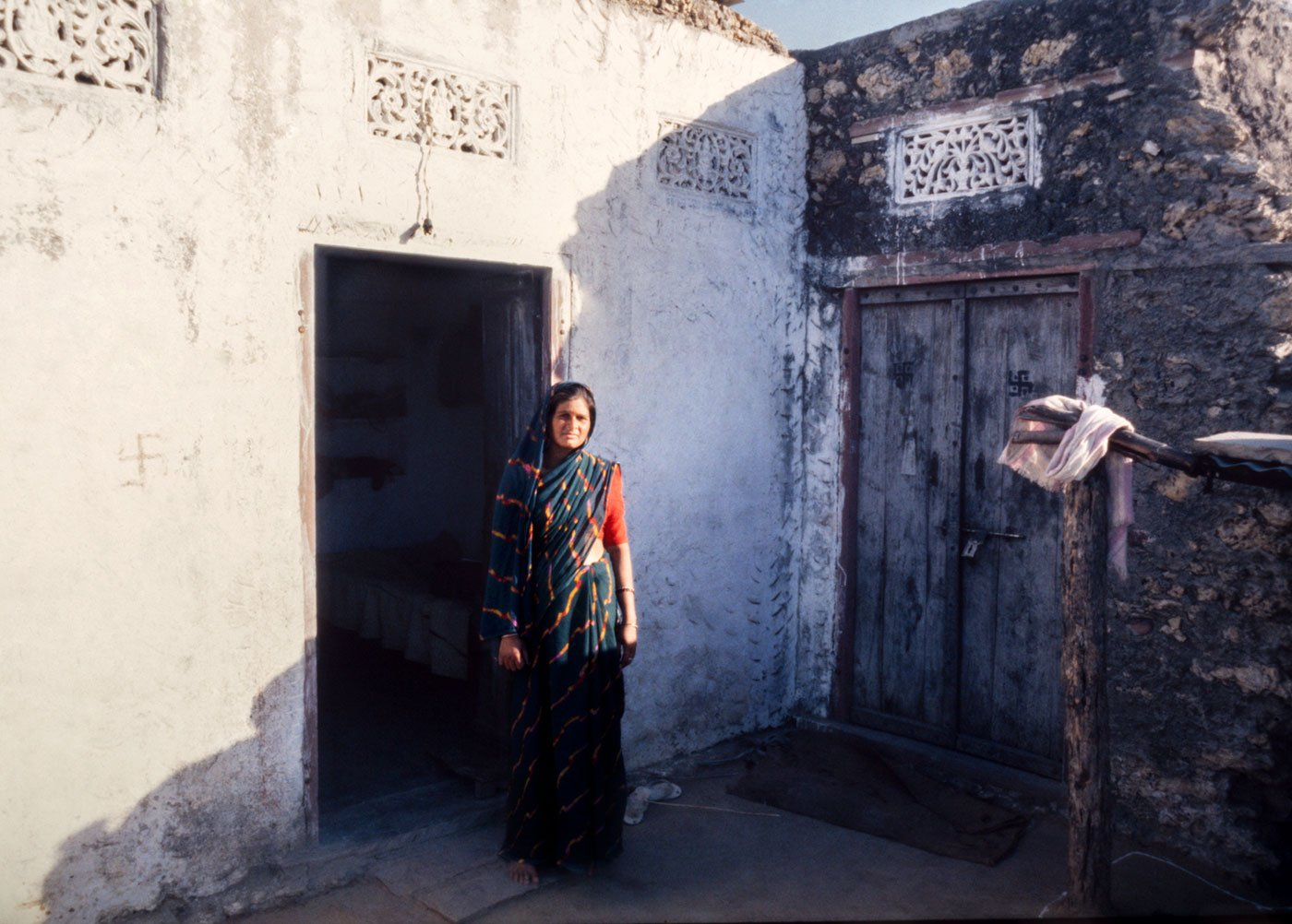 Anju Phulwaria, the persecuted sarpanch, standing outside her house