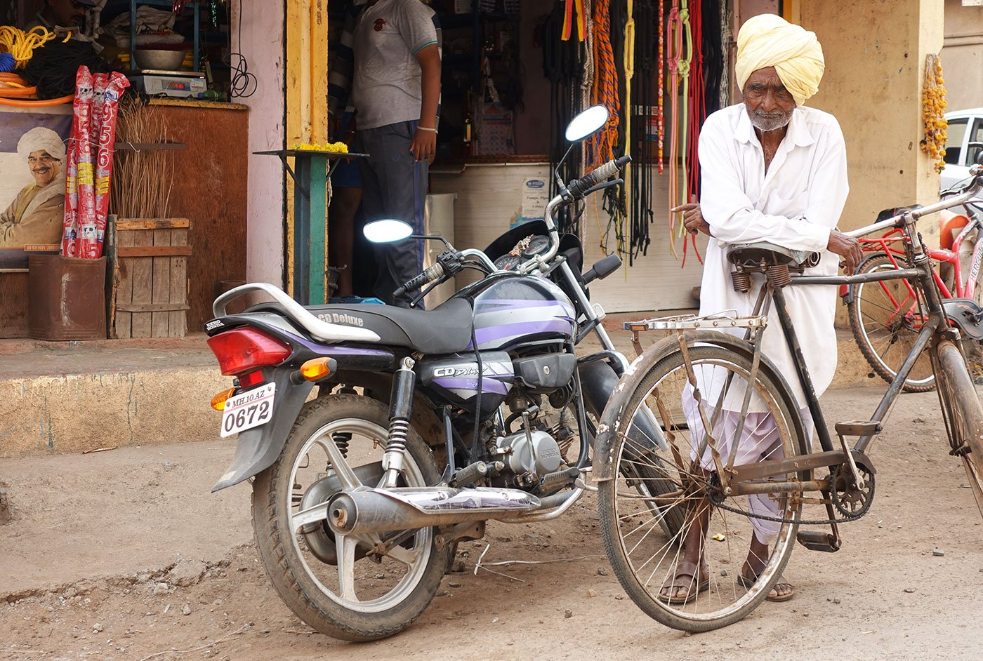 Ganpati Bala Yadav with his cycle outside a shop