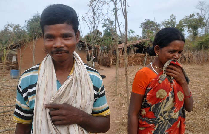 A man and a woman in front of their home in Chintalpadu village