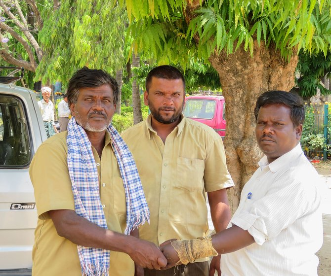 Puttanna (left) and Manjunath (middle) have been working as manual scavengers, an illegal occupation, for 11 years now. In this photo, they are standing next to Siddhagangaiah (right), a coordinator at Dalit rights group, Thamate.