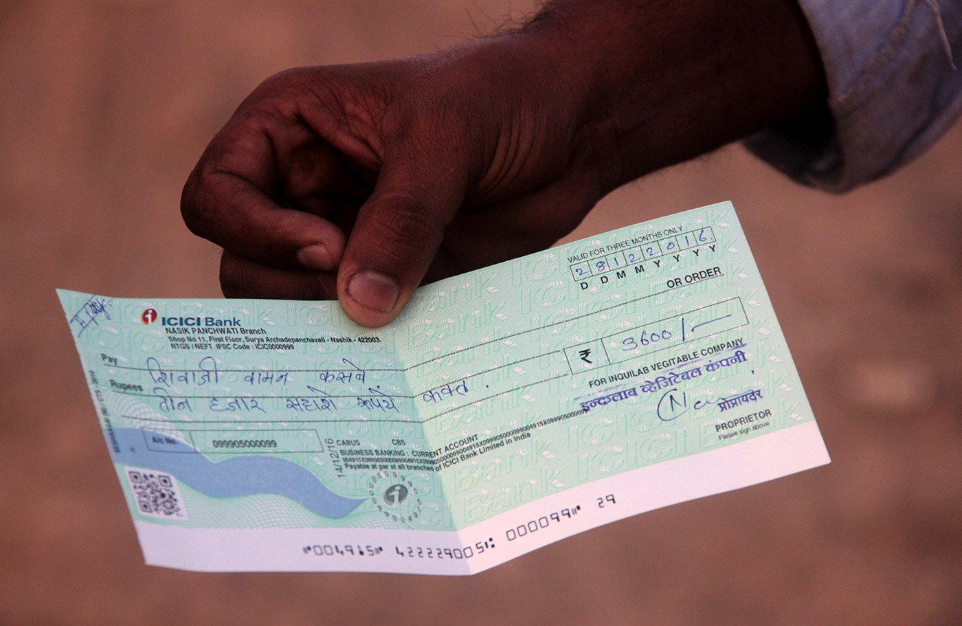 A cheque in the name of Vijay Kasbe's father – he was forced to take one since his trader did not have currency, but would be helpless if it bounced