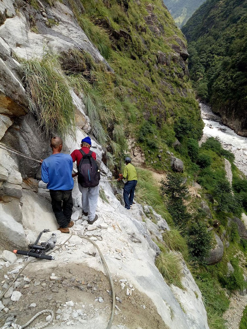 When a landslide washed away the route in Malpa in August 2017, residents walked by holding ropes.