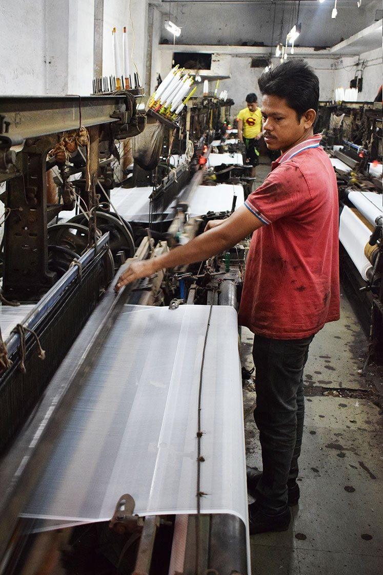 Simanchala Sahu, a migrant worker from Odisha's Ganjam district has been working in a powerloom unit on Ved Road for the last two decades. He works for 12 hours every day, and gets paid on a piece-rate basis