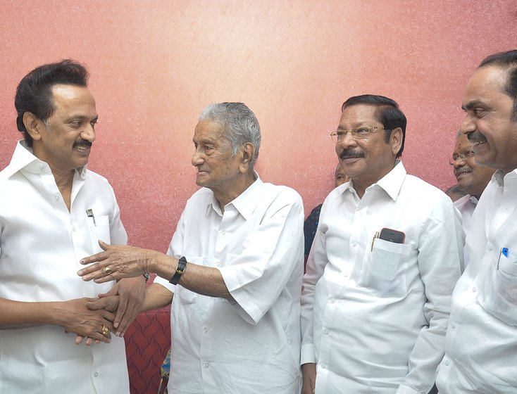 Left: DMK leader M.K. Stalin greeting Sankariah on his 98th birthday in 2019. Right: Sankariah and V.S. Achuthanandan, the last living members of the 32 who walked out of the CPI National Council meeting in 1964, being felicitated at that party's 22nd congress in 2018 by party General Secretary Sitaram Yechury