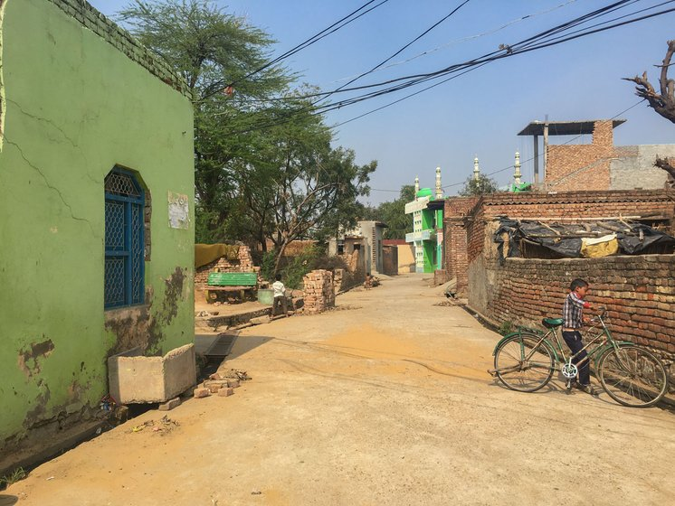 Biwan village (left) in Nuh district: The total fertility rate (TFR) in Nuh is a high 4.9. Most of the men in the village worked in the mines in the nearby Aravalli ranges (right)
