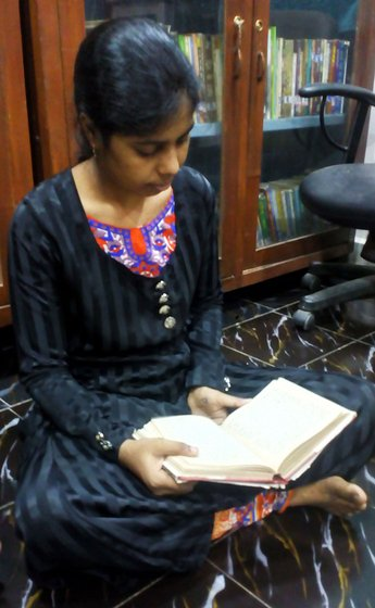 Zardab Shah reading a book at the library