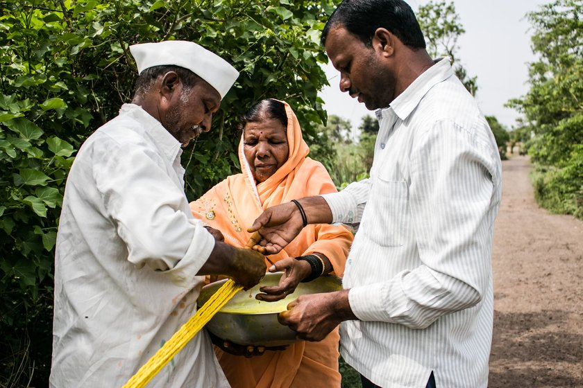 The Bhore family – Devu (wearing cap), Nandubai  and Amit  – craft ropes for farmers. There's been no work now for weeks