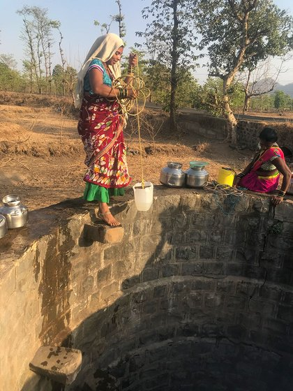 Nandini Padwale standing on the well