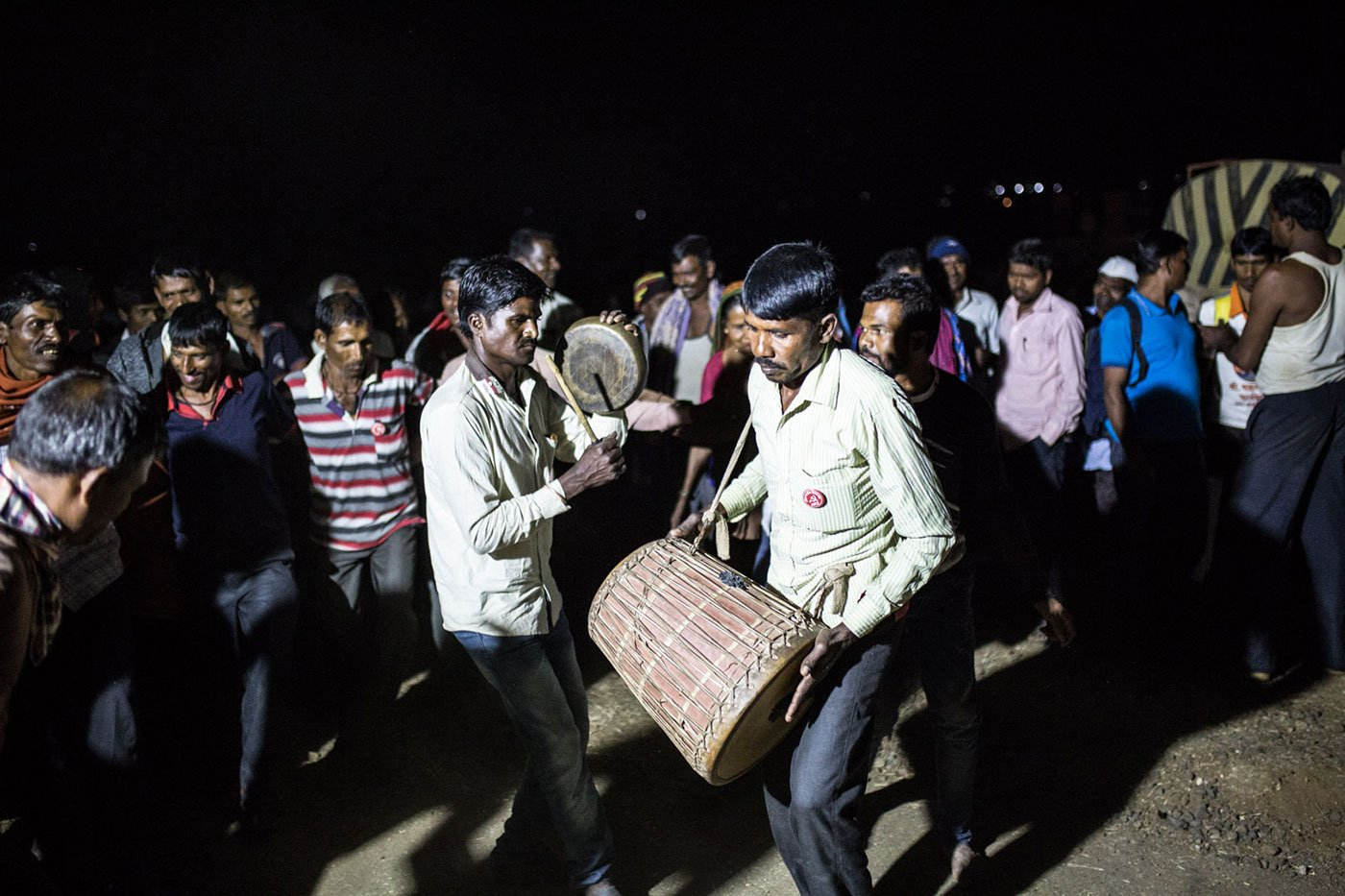 After a long day of walking, some farmers sing and dance at night.