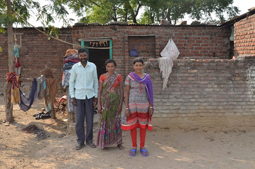 Surnita Pawar with husband and elder daughter outside their house
