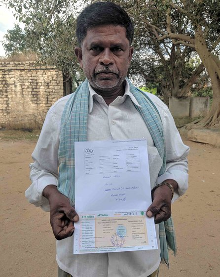 "Mahammad with his (orange coloured) October receipt and MRO office print out. The orange receipt was retrived from Mee Seva ('At your service'), after he was sent back from MRO office. The reciept acknowledges the request to add his name back onto his family's ration card. The white print is given by operator at MRO office, which says ""..uid already exist in the.."". The photo was taken outside the MRO office after we got the white print out"