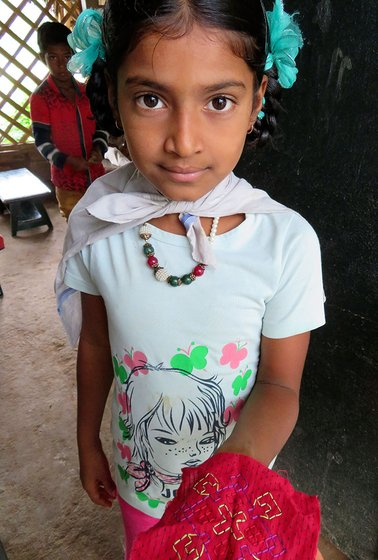 Little girl showing a design
