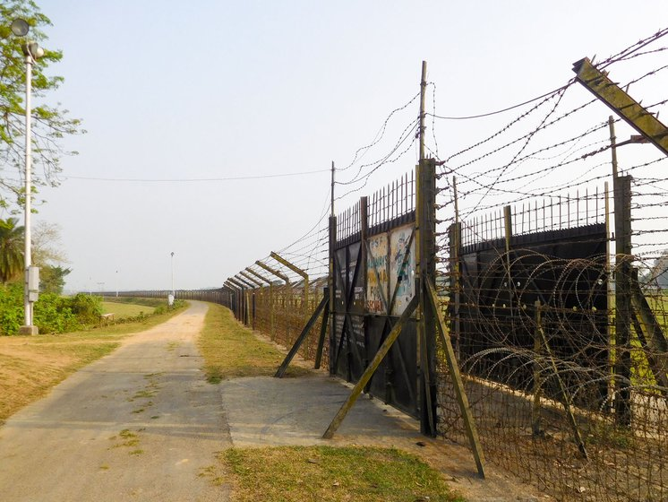 The road and gate at the border on the India side. At times, fights break out when cattle stray across, or straw is stolen or demarcation lines are disputed