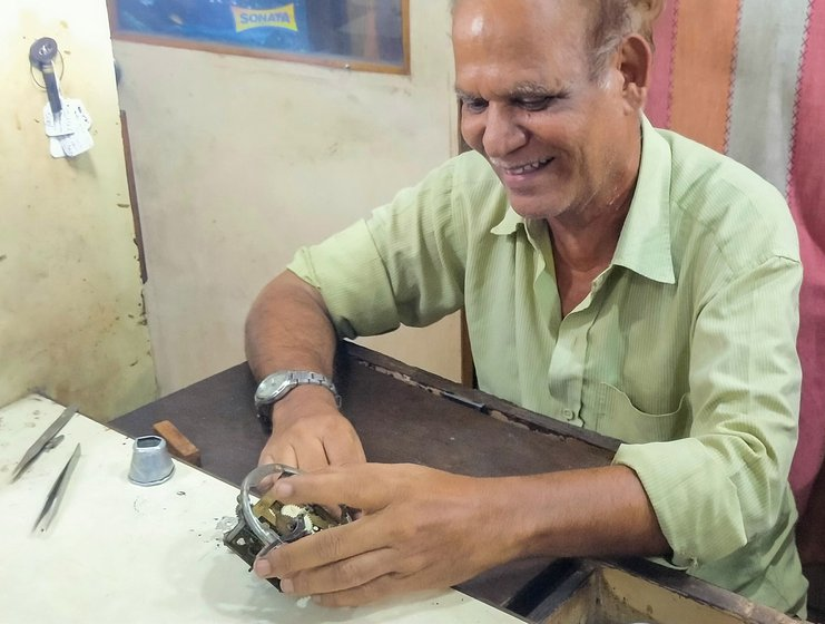 'Even before the coronavirus, I had very few watches to repair. Now it's one or two a week', says Habibur, who specialises in vintage timepieces (left)