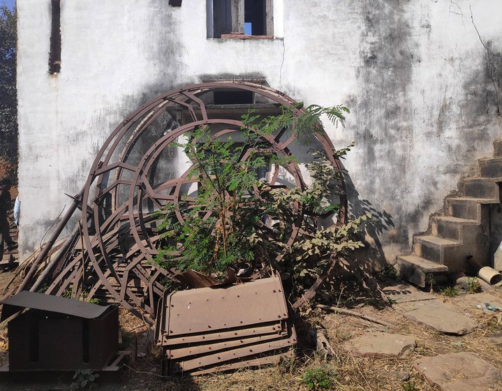 Mangal Singh's factory where scraps of metal and machines used to build the turbine's parts lie unused