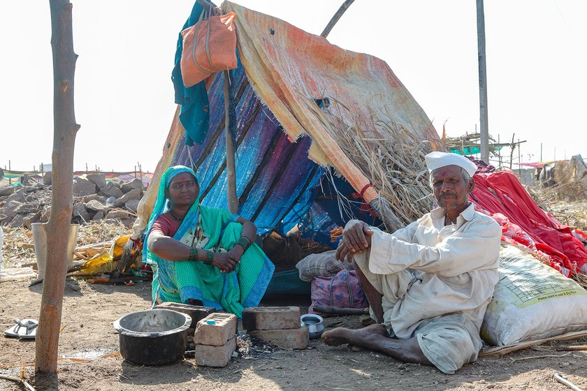 Lakshmi and her husband Paramaeshwar sitting outside her tent