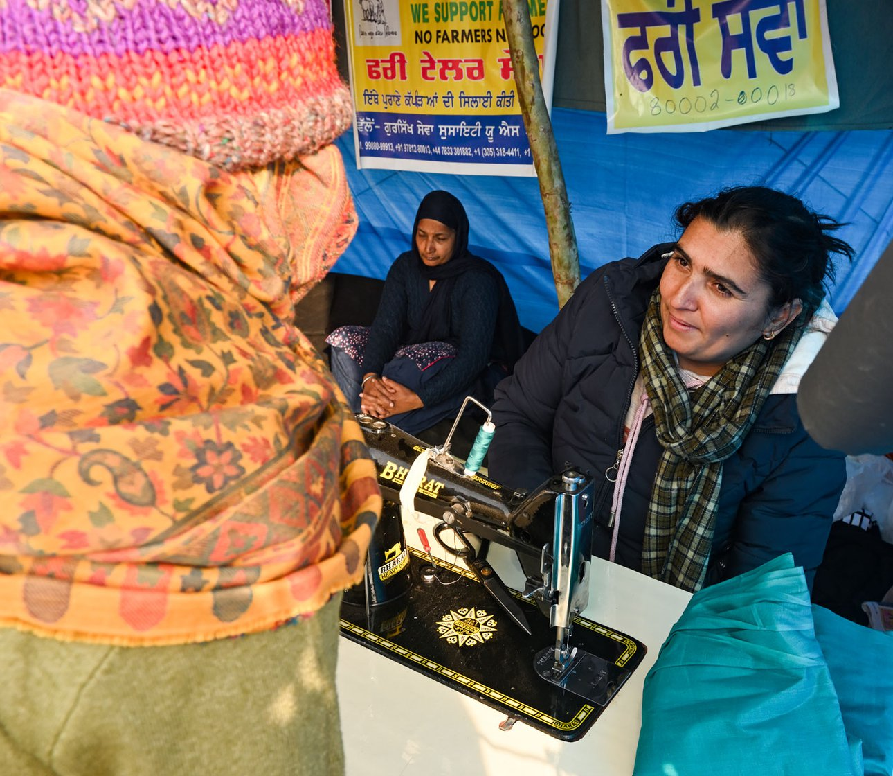 Kamaljit Kaur, a teacher from Ludhiana, and her colleagues have brought two sewing machines to Singhu, and fix for free missing shirt-buttons or tears in salwar-kameez outfits of the protesting farmers – as their form of solidarity