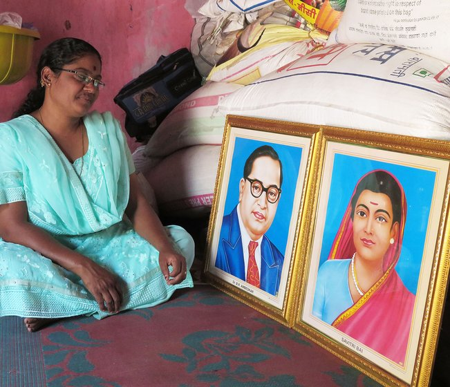 Sunita Bhosle with Ambedkar and Savitribai Phule's photo