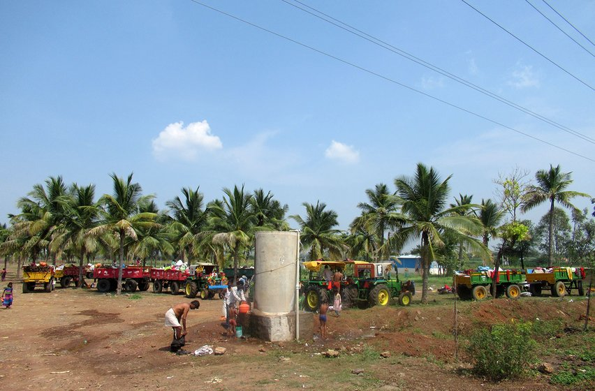 The migrants freshen up at Belgaum ahead of their first day at a sugar factory