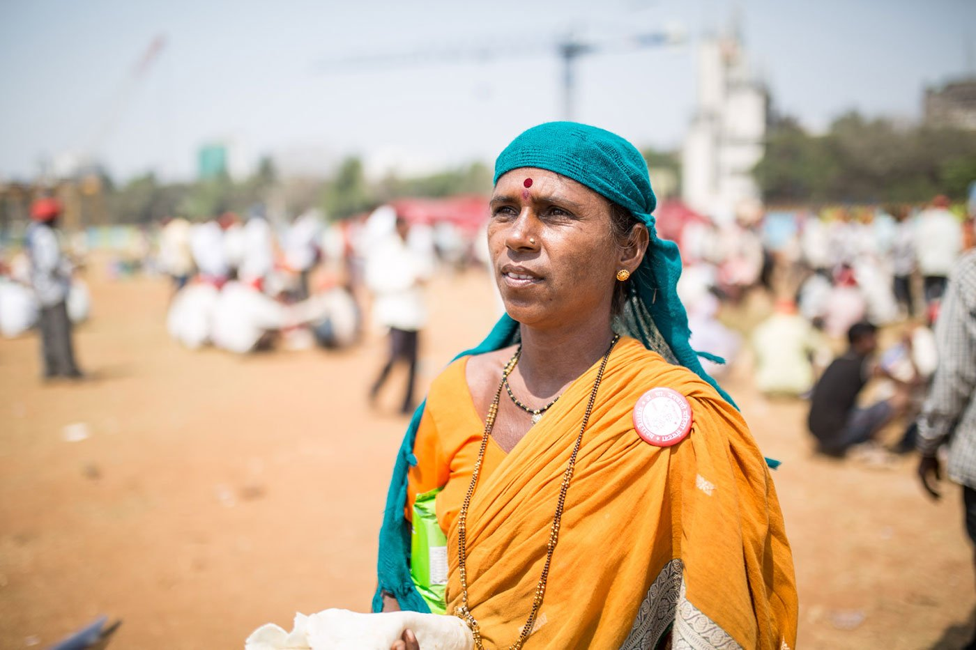 A woman standing at Azad Maidan