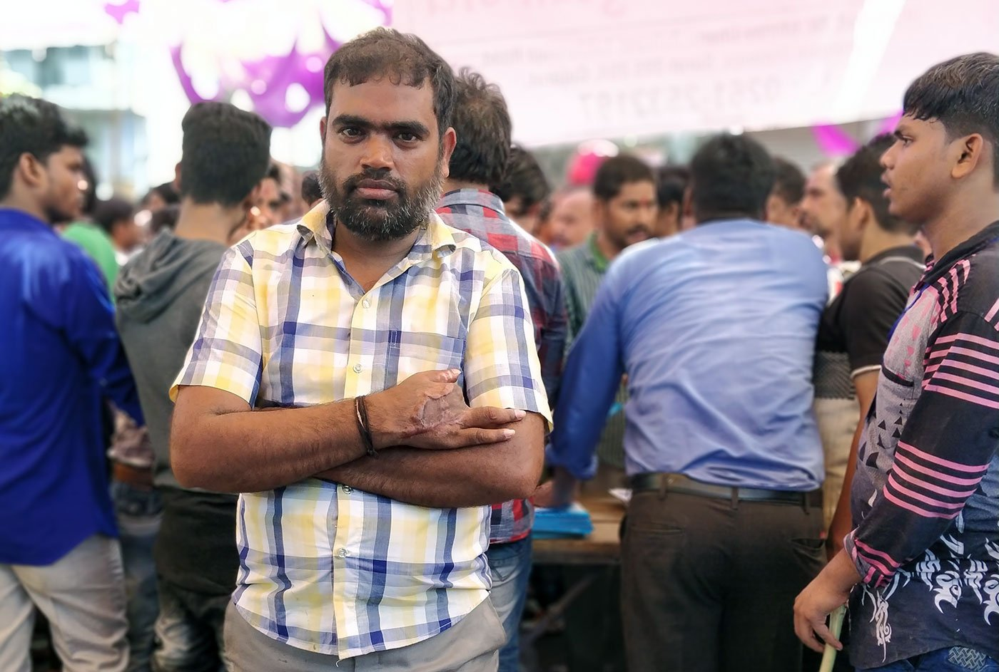 Rushikesh Rout, 38, a former powerloom unit worker lost three fingers in a freak accident in June last year. He now works as a security guard, carrying with him little hope to be compensated for his lost fingers.