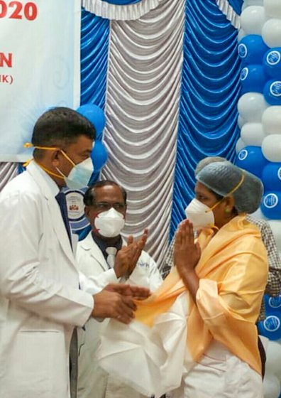 Thamizh Selvi in a PPE suit (let) and receiving a 'Covid-warrior' award at a government hospital (right) on August 15, 2020, for her dedicated work without taking any leave