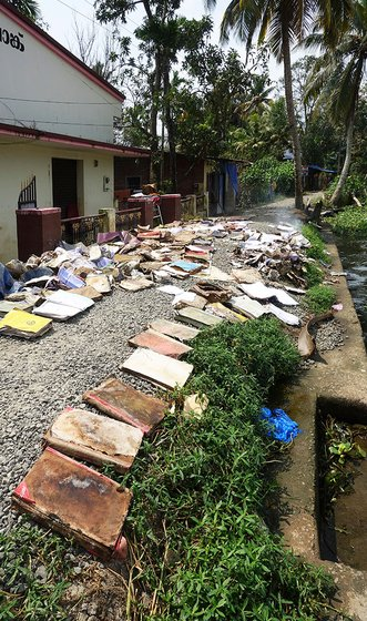 Documents and books drying on the banks of the river outside the bank