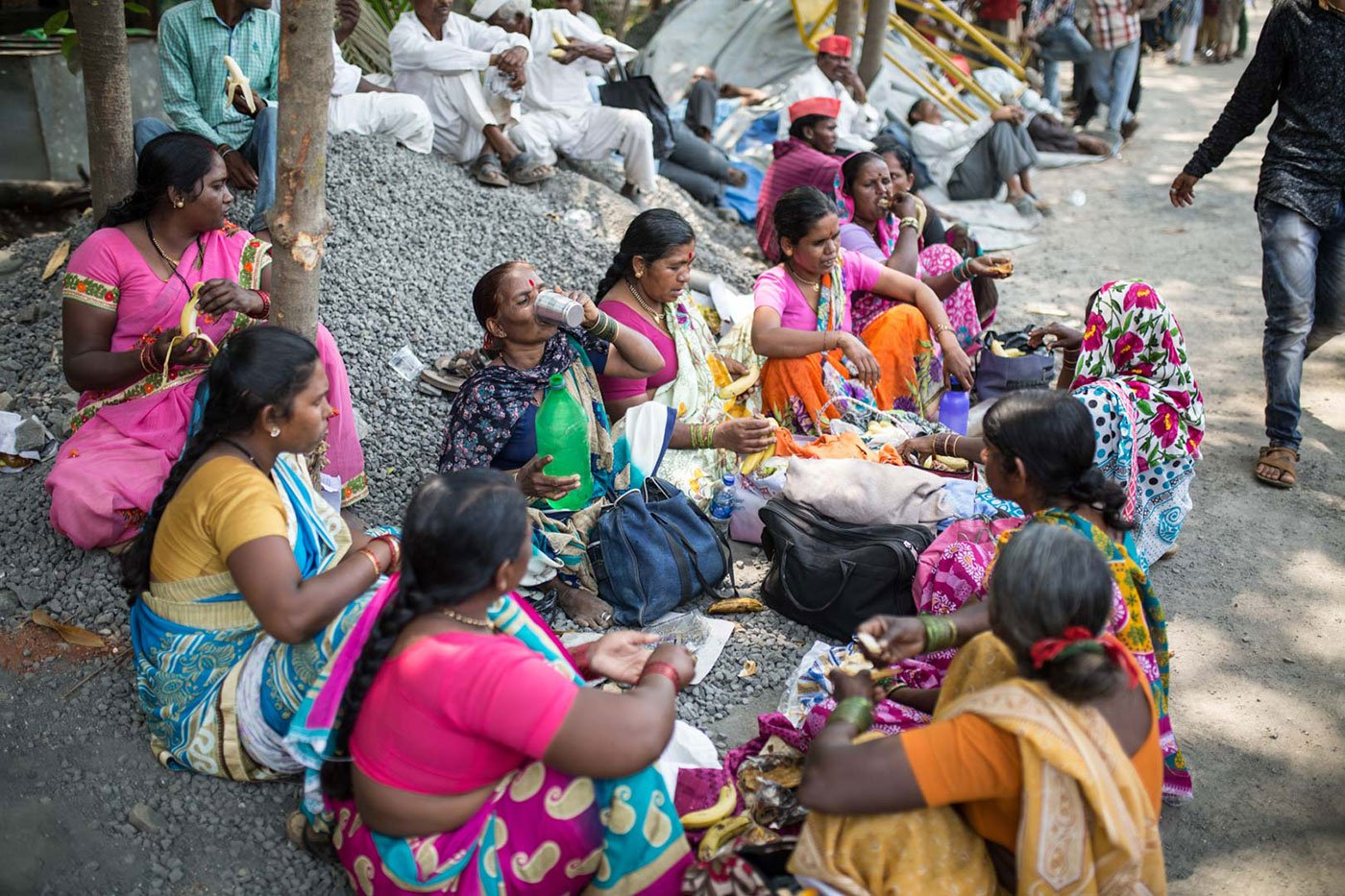 A group of women, including Shantabai Waghmare, 50, eating lunch