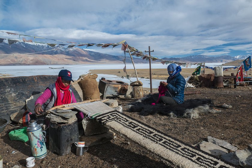 In Korzok village, Tsering Norzom and Sanoh Dolkar are unperturbed by the freezing winds blowing over the frozen Tso Moriri lake. They are busy making a carpet and sweater with wool from their own herd of goats and sheep