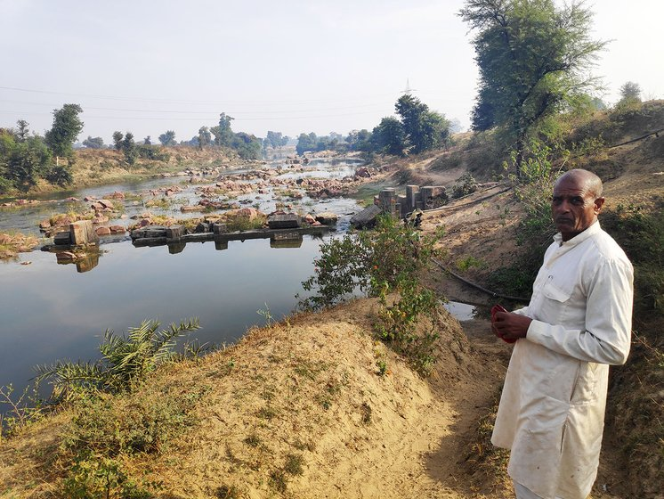 Shivdayal Rajput at one of the sites where the Mangal Turbine was installed. The broken check dam can be still seen