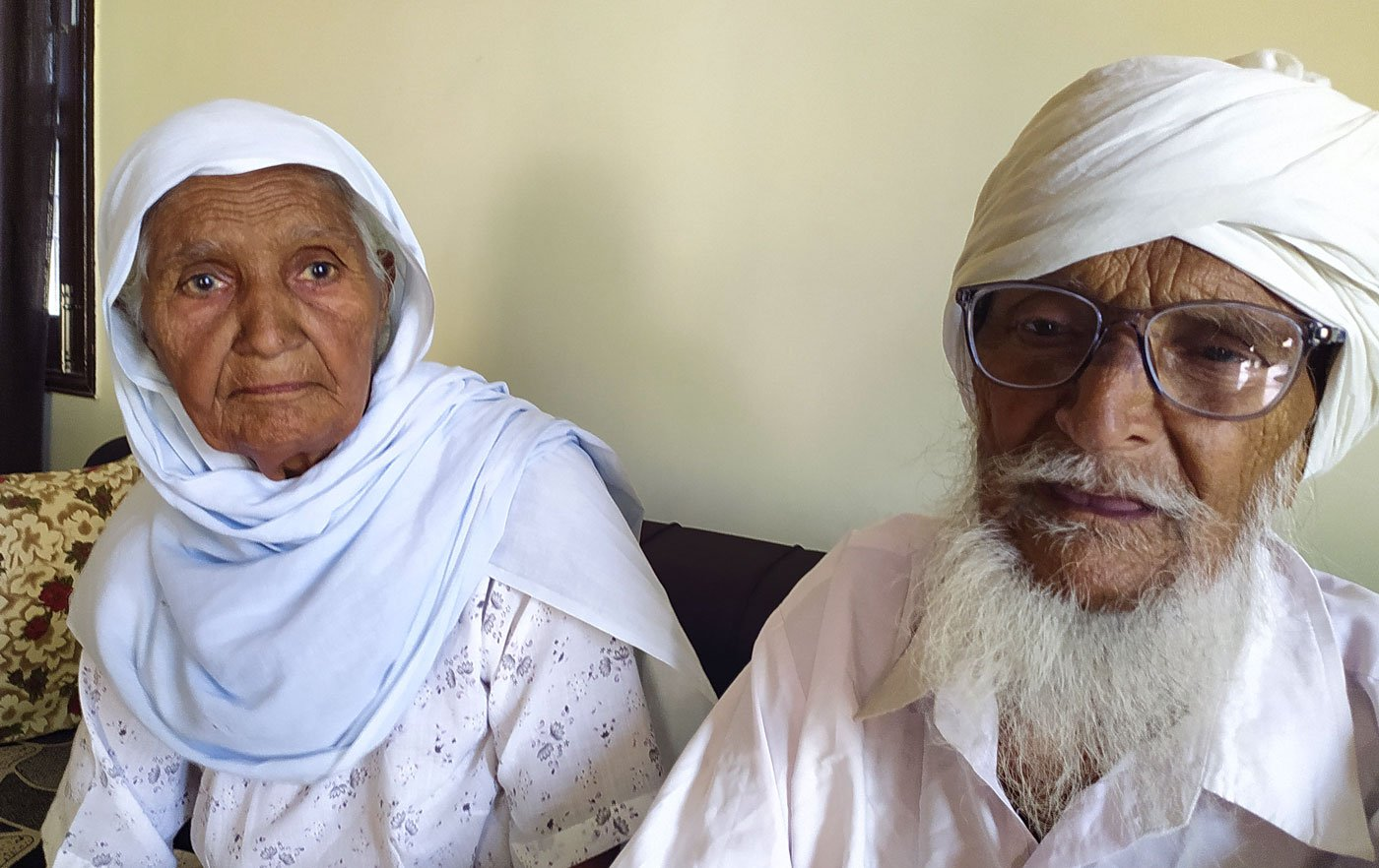 Bhagat Singh with his wife Gurdev Kaur at their home in Ramgarh. Right: He has sold off his 12-bore gun as, he says, now even 'a child could snatch it from my hands'