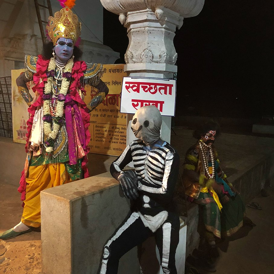 actors in their get up standing outside the temple