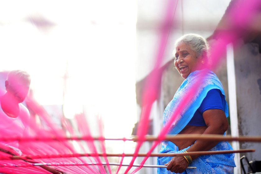 Manonmani Punnakodi and her family members prepare the warp early in the morning. The loom is washed with rice water. The starchy water helps separate the threads quickly and crisply. They are separated to a particular count for the loom