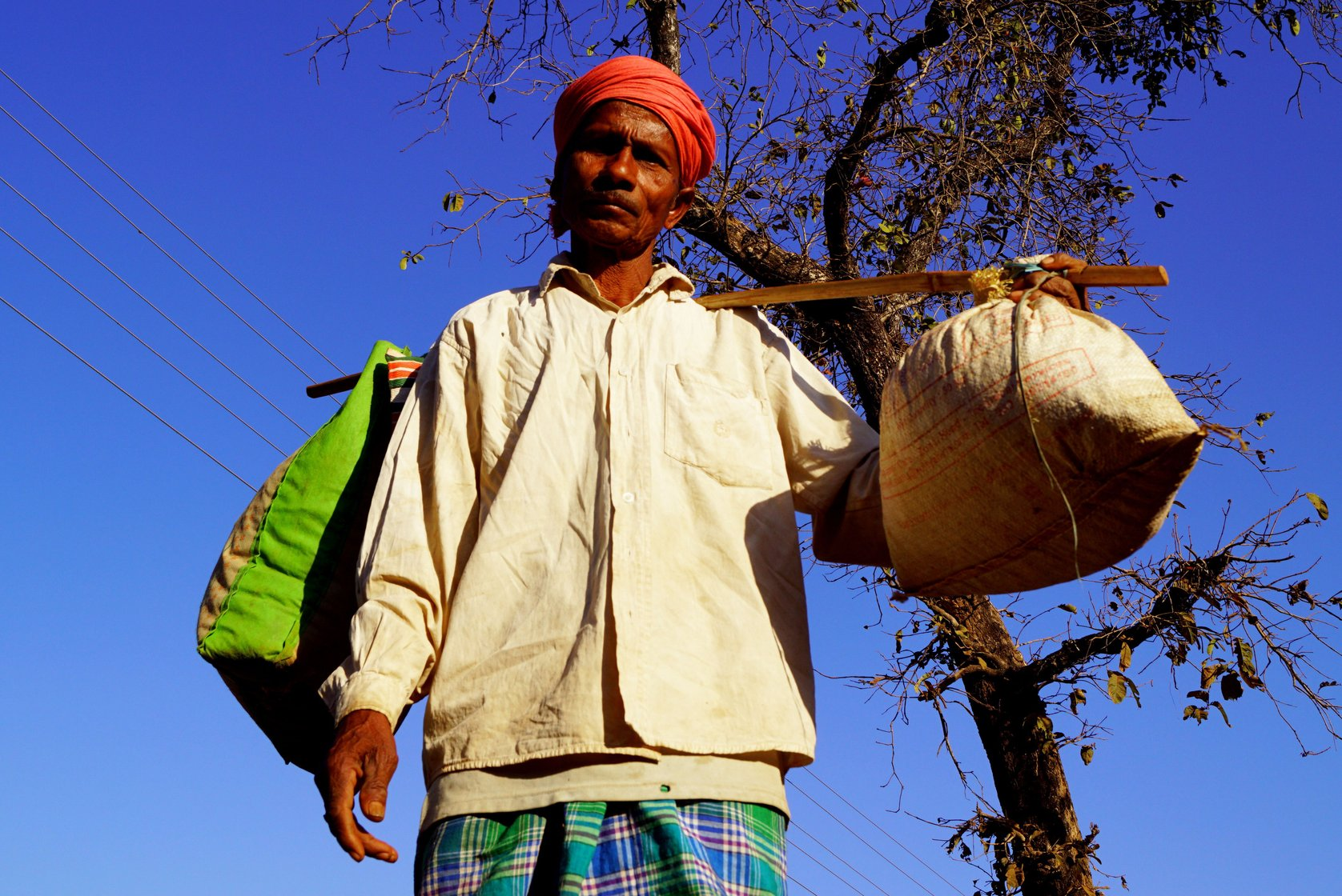 Itwaru, a farmer and farm labourer from nearby Kohcur village, is here to purchase mahua flowers and grapes to make wine
