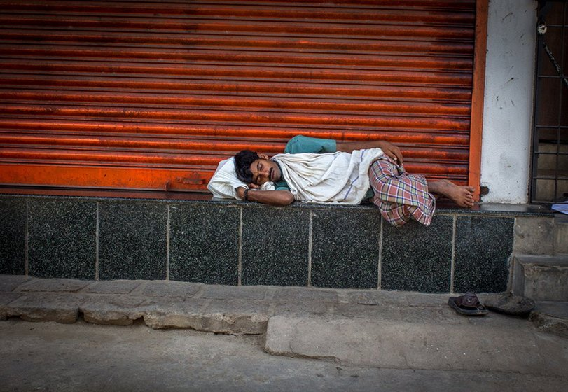 A labourer, who has found no work for the day, goes to sleep around 10 a.m