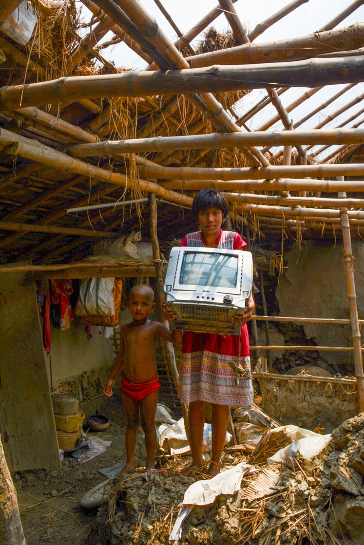 Left: Debika Bera, a Class 7 schoolgirl, in what remains of her house in Patharpratima block's Chhoto Banashyam Nagar village, which Cyclone Amphan swept away. The wrecked television set was her family's only electronic device; she and her five-year-old sister Purobi have no means of 'e-learning' during the lockdown. Right: Suparna Hazra, 14, a Class 8 student in Amrita Nagar High School in Amtali village, Gosaba block and her brother Raju, a Class 3 student