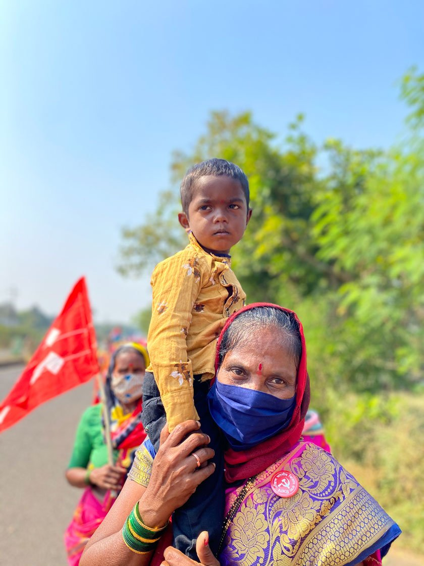Left: Sukhi Wagh, a construction labourer, carries her three-year-old grandson Sainath on her shoulder as they march towards Khandeshwari Naka for the rasta roko protest. 'Give us rations, we have no work', she said. Right: Protestors walking towards Khandeshwari Naka