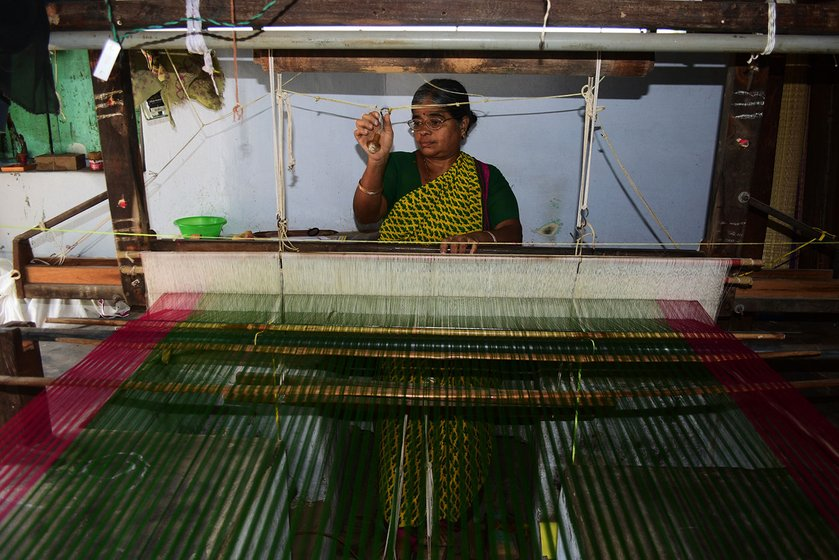 Jayakantha Veerabathiran,  45, weaves a plain saree that will later be embellished with  embroidery. In most homes, the looms are placed on the floor with a  shallow pit  for the pedals