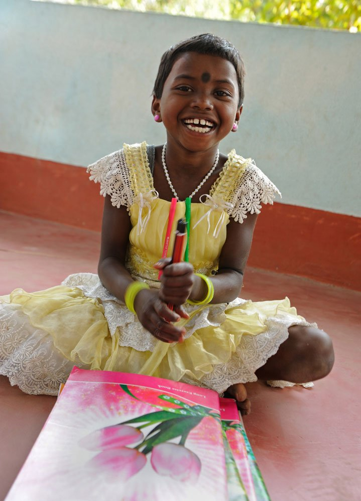 Binata Hembram, 8, is always smiling radiantly, and clearly loves her school work